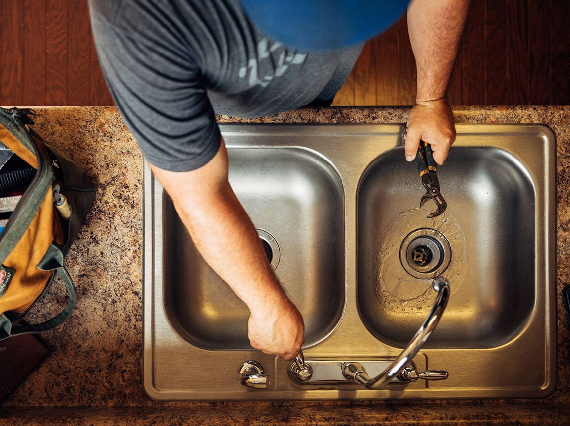 a man checking the sink